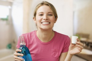 Woman Holding Mouthwash